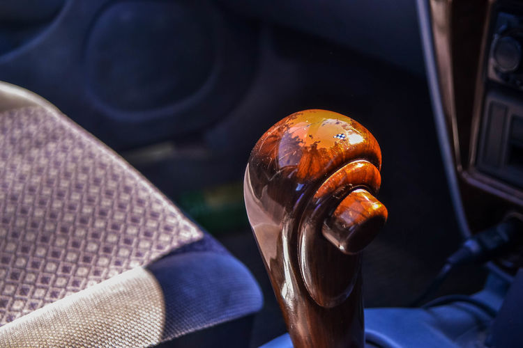 Close-up of hand holding black car