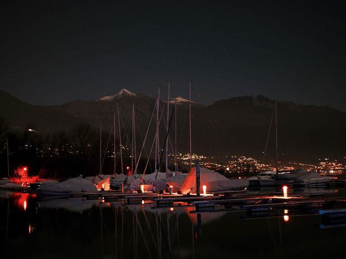 Arts Culture And Entertainment Beauty In Nature Harbor Illuminated Lake Mountain Nature Nautical Vessel Night No People Outdoors Premiere Reflection Sky Star - Space Yacht