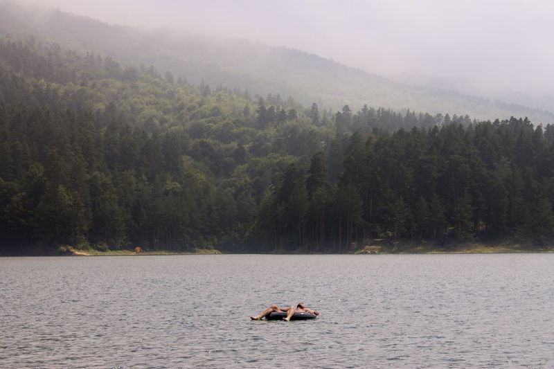 View Of Person Floating On Lake