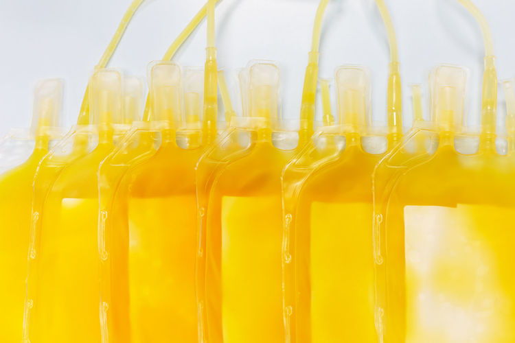 Close-up of yellow bottles in glass container