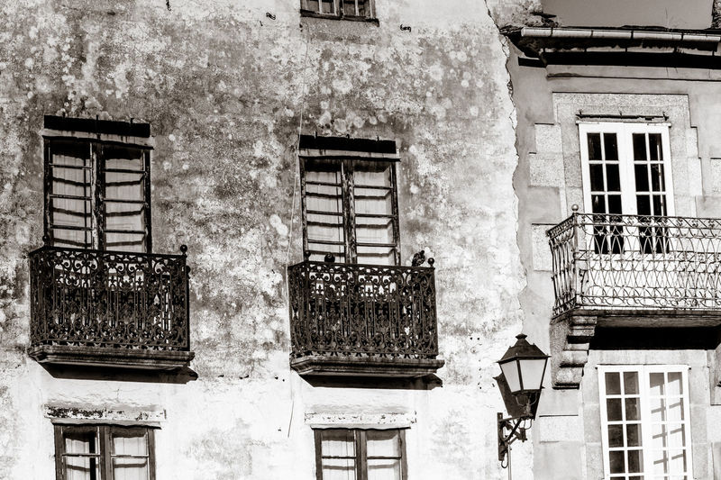 Architecture Balconies Black And White Building Exterior Built Structure Day Facades Low Angle View Monochrome No People Old Buildings Outdoors Residential Building Street Photography Streetphoto_bw Town Traditional Architecture Village Window