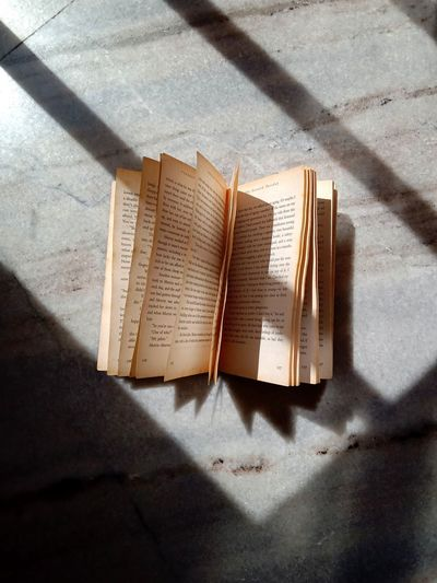 High angle view of open book on sunny day