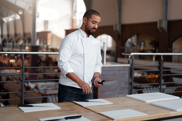Full length of man working at table