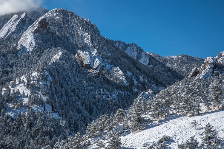 Mountain Cold Temperature Snow Scenics - Nature Winter Beauty In Nature Sky Nature Mountain Range Landscape No People Environment Day Tranquility Non-urban Scene Tranquil Scene Frozen Snowcapped Mountain Plant Mountain Peak Outdoors Formation Extreme Weather Boulder Colorado Boulder Winter Wonderland Flatirons Rocky Mountains Colorado