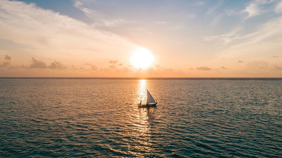 Sunset 🌅 Sailing Maldives Resorts Maldives EyeEm Selects Water Sky Sea Sunset Beauty In Nature Scenics - Nature Horizon Over Water Nautical Vessel Waterfront Cloud - Sky Horizon Transportation Mode Of Transportation Tranquility Sun Nature Sunlight Idyllic Tranquil Scene