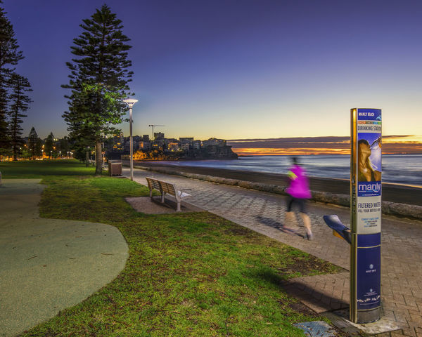Manly Lifestyle Manly Beach Sydney Real People Architecture Motion Blurred Motion Lifestyles One Person Grass City Life Women Beach Jogging
