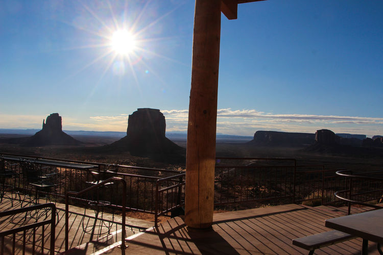Sky Sunlight Sun Nature Sunbeam Lens Flare Architecture No People Day Scenics - Nature Beauty In Nature Built Structure Sunny Tranquility Mountain Tranquil Scene Railing Outdoors Water Clear Sky Bright Monument Valley,Utah USA Monument Valley Tribal Park Monument Valley