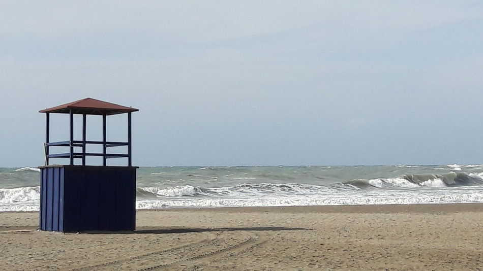 Beach Sand Sea Lifeguard Hut Lifeguard  Horizon Over Water Summer Sky Outdoors Protection Day No People Architecture Vacations Water Built Structure Tranquility Building Exterior Nature Benalmádena, Malaga, Spain Beauty In Nature Vacations