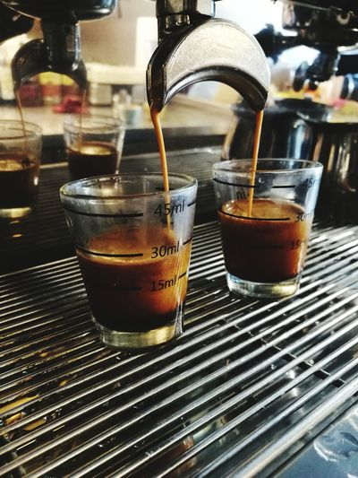 Close-up of coffee machine filling glass