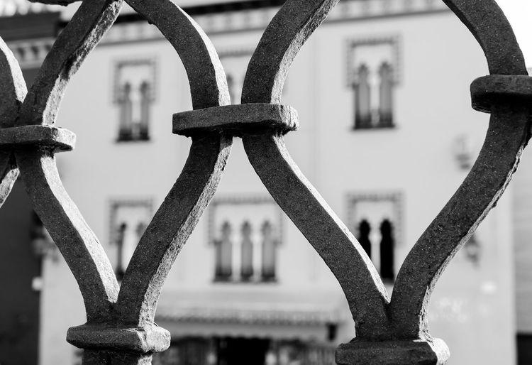 Close-up of chain hanging on bridge