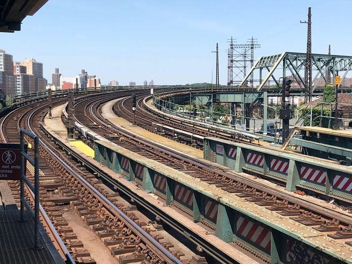 Railway bridge in city against clear sky