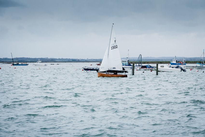 Anglia Boats Channel Coast English Essex Estuary High Tide Hobby Holiday Island Leisure Maritime Mersea Mersea Island Nautical Pastime Sailboat Sailing Sea Seafarer Vacation Vessel West Mersea Yacht Let's Go. Together.