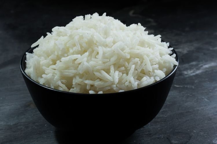 Cooked Basmati rice served in black bowl Basmati Rice Black Bowl Bowl Bowl Of Rice Close-up Cooked Rice Dark Food Grains Healthy Eating Indian Dish Indoors  Long Grain Moody Ready-to-eat