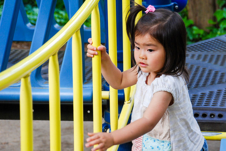 High Angle View Of Girl On Jungle Gym At Park