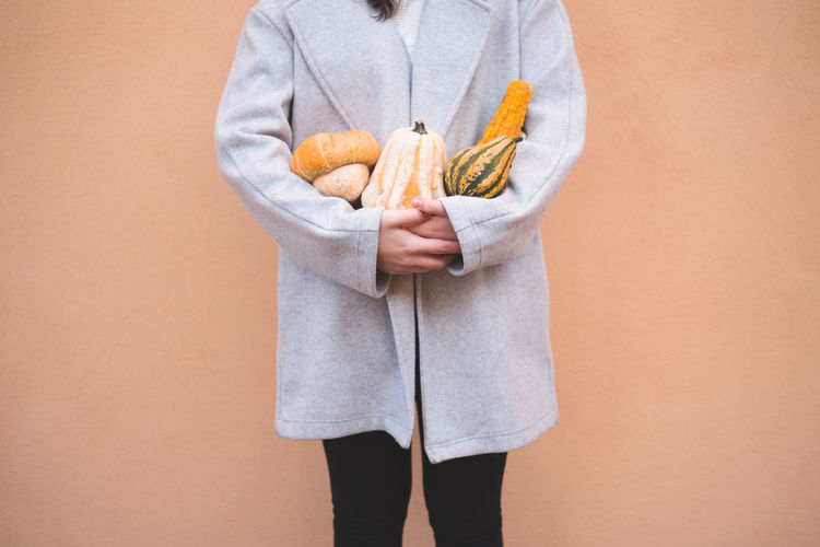 Autumn Mood Holding Standing One Person Food And Drink Food Midsection Studio Shot Colored Background Healthy Eating Front View Wellbeing Indoors  Healthy Lifestyle Freshness Casual Clothing Orange Color Men Clothing Beige Background Dieting Orange Background Tray
