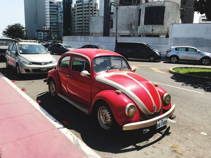 VW Beetle VW Old School Mode Of Transportation Motor Vehicle Land Vehicle Car Transportation City Building Exterior Stationary Retro Styled No People Nature Travel Day Sunlight Road Red Architecture Built Structure Street
