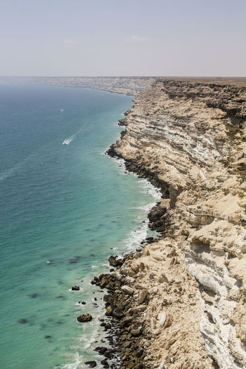 Offroad trip from Muscat to Salalah: steep costline near al Duqm 4x4 Adventure Arabic Boat Coast Coastline Driving Dry Fisherman Horizon Over Water Landscape No People Offroad Oman Oman_photography Outdoors Road Rock Sand Sea Shore Spectacular Trip Water Wide