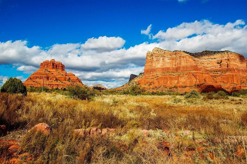 Nature Beauty In Nature Rock - Object Rock Formation Geology Landscape Sky Travel Destinations Scenics Cloud - Sky Blue Outdoors Tourism Tranquility No People Canyon Grass Day Desert Arizona SEDONA ARIZONA