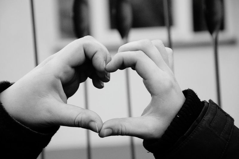 Cropped hands making heart shape