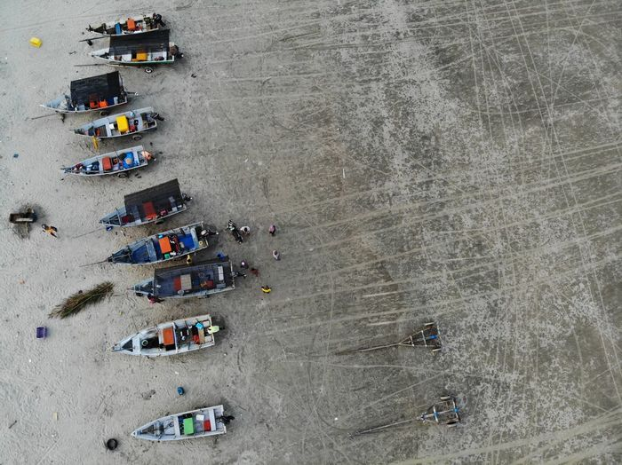 Aerial view of people at boats at beach