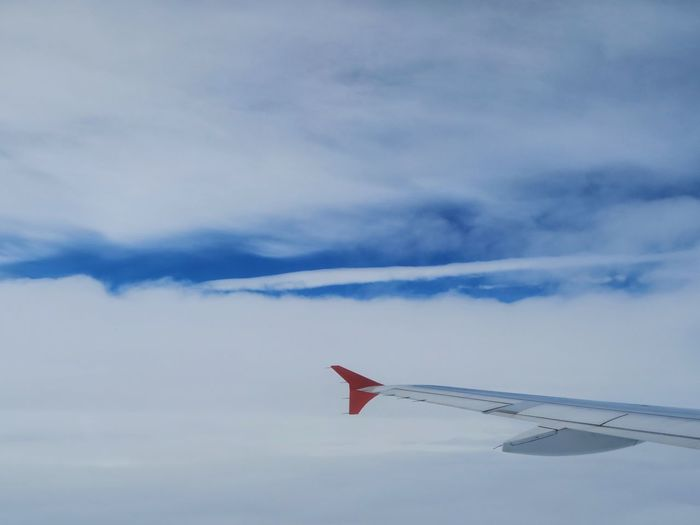 Low angle view of airplane wing against sky