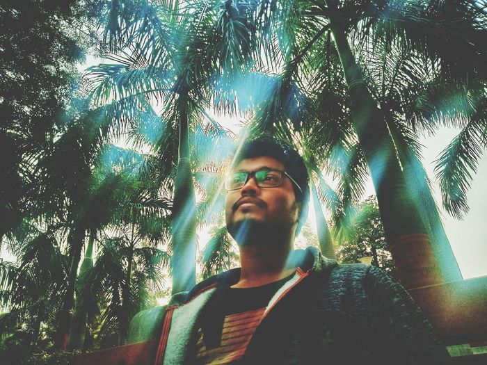 Rays of happiness! Sun Beams Shadows & Lights Happiness Portrait Cyberspace Tree Front View Close-up Sky Sunglasses Glasses Head And Shoulders Asian  Hood Vision Thoughtful EyeEmNewHere A New Perspective On Life Capture Tomorrow Moments Of Happiness