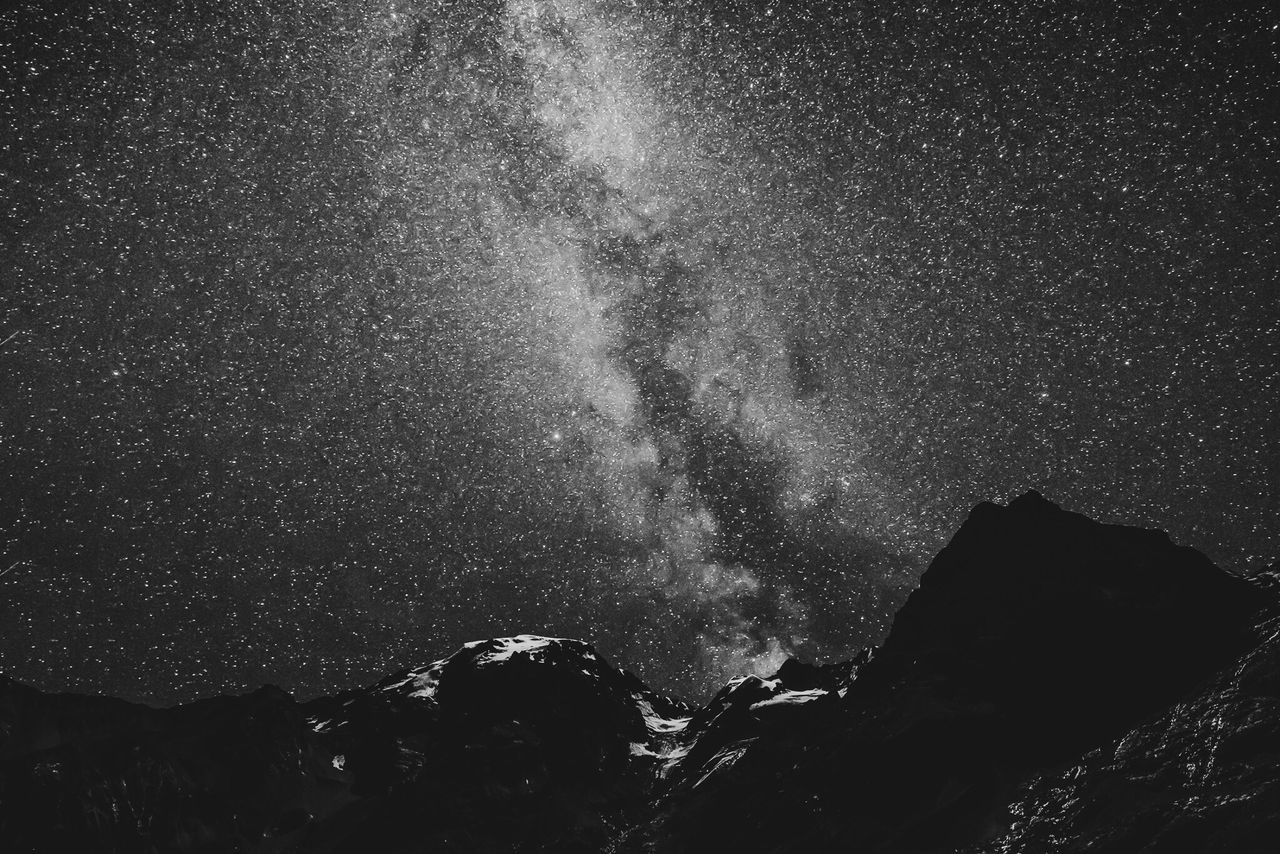 LOW ANGLE VIEW OF SKY AND MOUNTAIN AT NIGHT