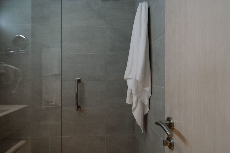 Towel hanging on wall in bathroom at home