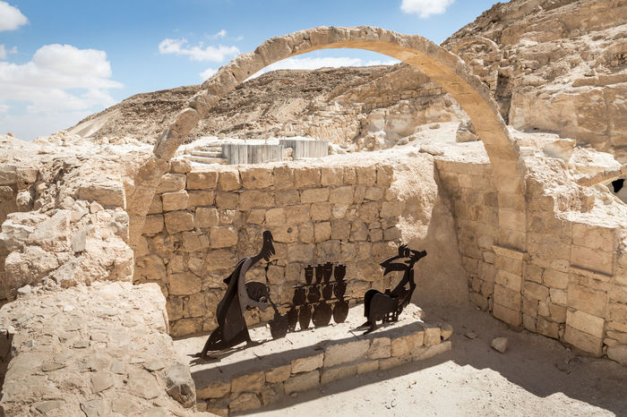 Mizpe Ramon, Israel, July 28, 2018 : Ruins of the Nabataean city of Avdat, located on the incense road in the Judean desert in Israel. It is included in the UNESCO World Heritage List. Archeology Architecture Avdat Castle Construction Nabataean City Negev Israel Ruins UNESCO World Heritage List. Ancient Civilization Arch Building Culture Famous Place Historic Incense Road Included Judean Desert Landmark Mountain Old Pillar Stone Material Tourism Travel Destinations
