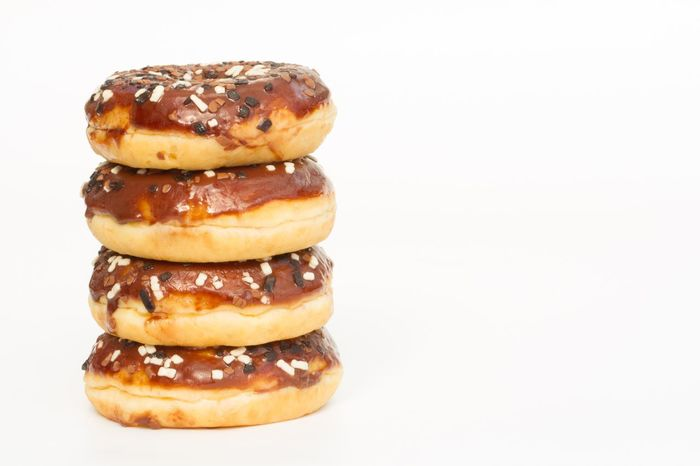 A stack of chocolate donuts with sprinkles on an isolated white background. Pile Stack Donuts Donuts🍩 Doughnuts Doughnut Chocolate Chocolate Donut Food Porn Treat Foodphotography Sweet Food White Background Sweet Foodporn Glazing Sugar Food Treats Fattening Unhealthy Eating Hundreds And Thousands Sprinkles Iced Icing