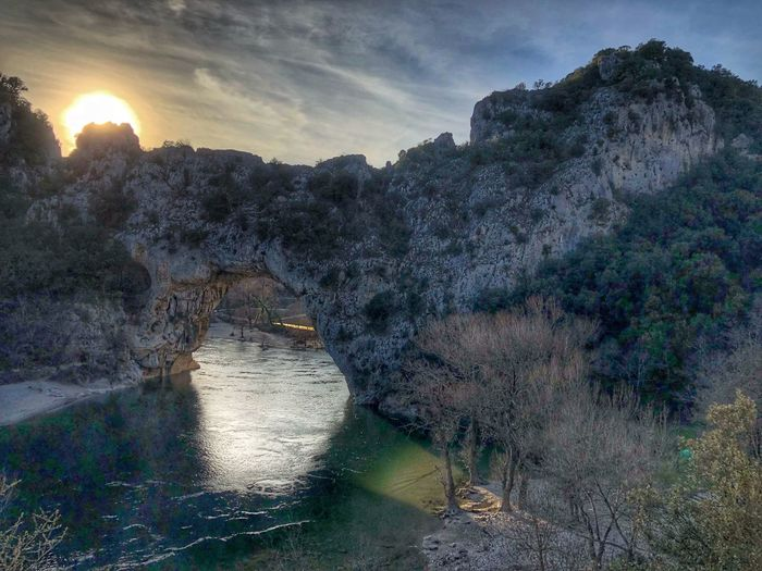 Pont d'Arc, Vallon pont d'Arc, Ardeche Ardeche France Ardeche River Ardeche Vallon Pont D'arc Le Pont D'arc Nature Water Beauty In Nature Outdoors Scenics No People Sky Tranquility Tree Landscape Sunset Tranquil Scene Sunlight Day