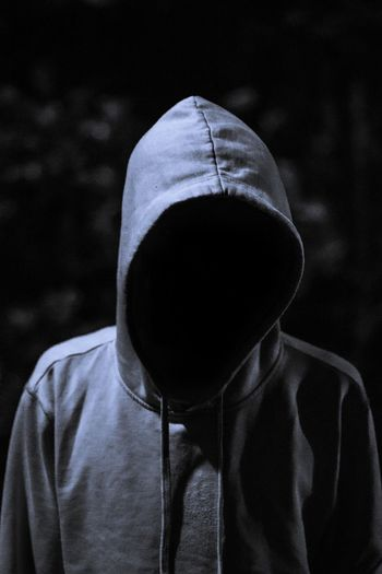 Invisible person wearing hooded shirt at night