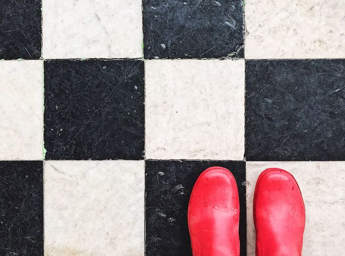 Close up of rubber boots on floor