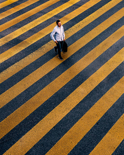 High angle view of woman walking on road
