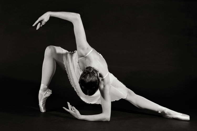 Ballet Moves, Ballerina Rebecca Flynn Ballerina Dance Adult Art Performance Balance Ballet Ballet Dancer Black Background Dancer Day Flexibility Full Length Indoors  Manouver One Person People Performance Real People Skill  Stretching Structures & Lines Studio Shot Young Adult Young Women