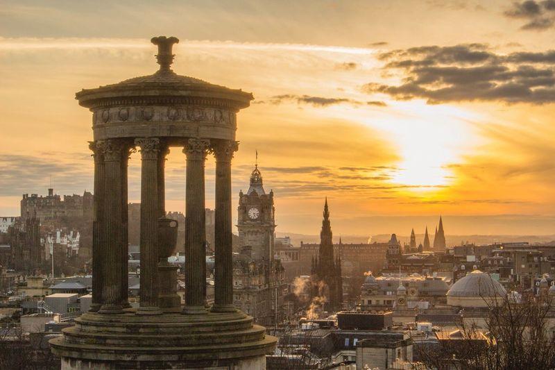 The sun setting over Edinburgh, taken from Calton Hill. Edinburgh Edinburgh Castle Scotland VisitScotland Calton Hill Dugald Stewart Monument Scott Monument Balmoral Hotel Sunset First Eyeem Photo The City Light