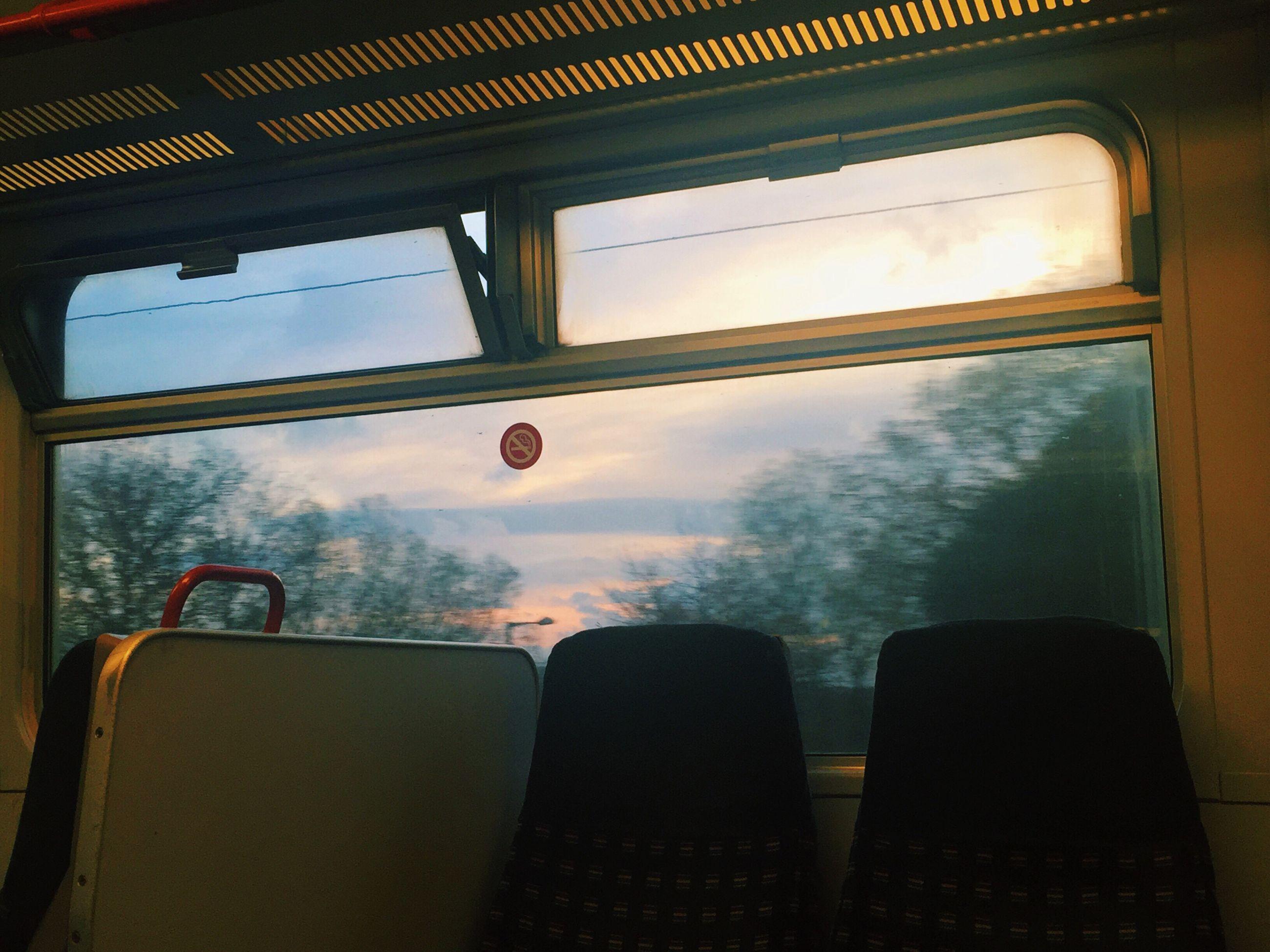 VIEW OF TRAIN SEEN THROUGH WINDOW