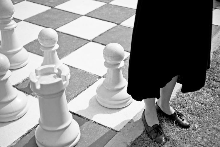 A women standing on the edge of a large chess board. Rebellion or women's rights concept image. Anarchism Anarchy Art Battle Black & White Board Chess Chess Board Concept Conform Conformity Corporate Disdain Dress Exit Edge Field Fringe Game Greener Government Harassment Individualism Individuality Intelligence Leaving Non Conformist Not Pawn person Perspective Femininity Pieces Playing Politics Rebel Anti Goverment Rebellion Rights Rules Sexual Harassment Society Strategy Thinking Outside Of The Box War Women Feminism