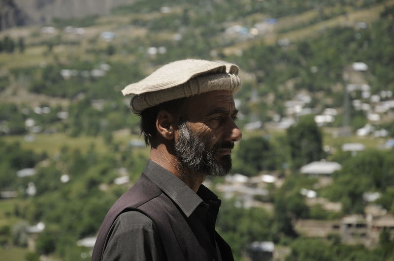 Portrait of local people in Pakistan Headshot One Person Portrait Adult Men Males  Focus On Foreground Clothing Real People Beard Hat Facial Hair Day Side View Lifestyles Nature Outdoors Looking Mature Adult Mature Men Redefining Menswear