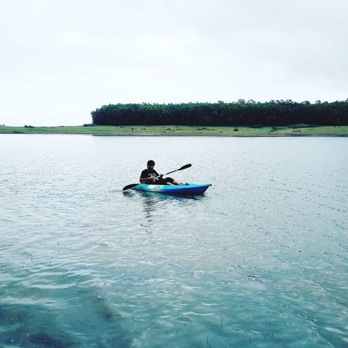 Kayaking Camping Kayaking River Adventure Travel River Alone Mood Sky Boat People Water Adult Only Men Full Length Outdoors Nature Sky Kayak Beauty In Nature First Eyeem Photo