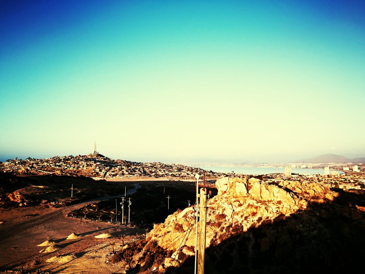 no people, clear sky, landscape, outdoors, nature, mountain, scenics, architecture, beauty in nature, day, sky, cityscape, city