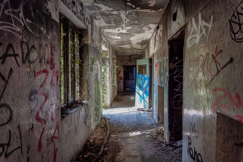 Graffiti Architecture Built Structure Building Abandoned Wall - Building Feature Indoors  No People Damaged Old Day Creativity Obsolete Art And Craft Decline Weathered Dirt Deterioration Text Messy Dirty Ruined Alley Mental Hospital