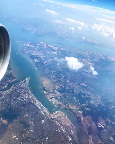 Aerial View Scenics - Nature Beauty In Nature Nature Water Cloud - Sky Sky Mode Of Transportation Airplane Air Vehicle Flying Transportation No People Sea Day Land Jet Engine Motion Outdoors Environment