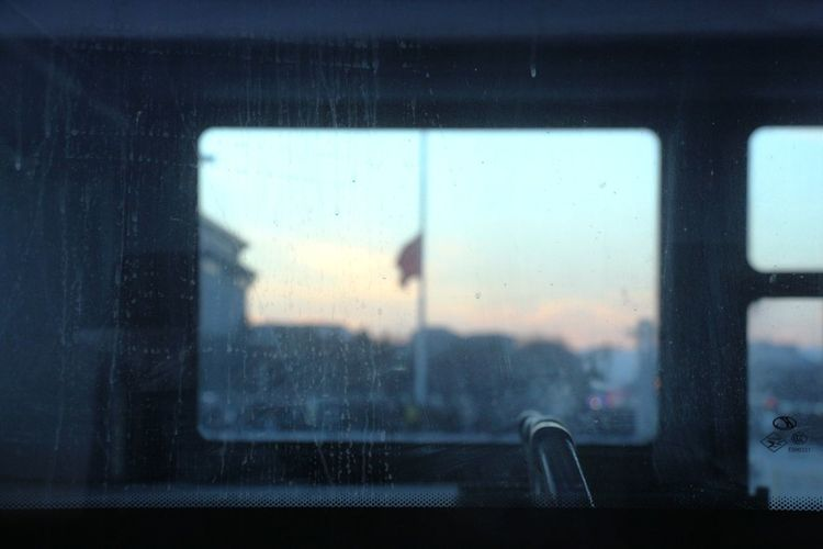 Close-Up Of Bus Glass Window