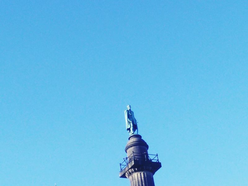 Statue Statue In The City Lone Wolf Hand In Pocket High Top Sunny Sunny Day Sky Blue Outside
