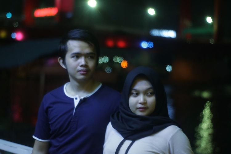 Lookin' to our future Couple Bokeh Ampera Bridge Ampera Future person Handsome Beautiful Two People Night Togetherness Young Adult Young Men Real People Front View Architecture Illuminated Men Portrait City Adult People Leisure Activity Young Women Looking At Camera Waist Up Outdoors Teenage Boys
