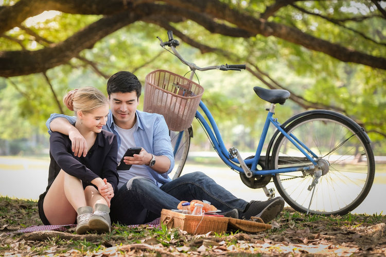 Young couple sitting on bicycle