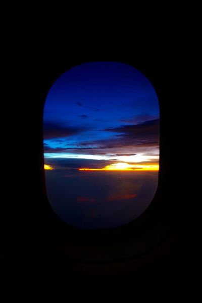 Out of the window Transportation Window Cloud - Sky Airplane Sunset Beauty In Nature Blue Scenics Sky Air Vehicle Mode Of Transport Dark Travel Sea Tranquil Scene Idyllic Atmosphere Tranquility Cloudscape Atmospheric Mood SONY A7ii Sony2470mm Plane