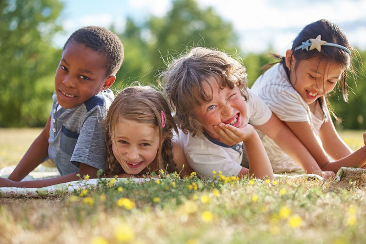 portrait of happy friends Autumn Bonding Boy Boys Carefree Cheerful Child Childhood Children Community Diversity Emotion Fall Family Females Flowers Friends Friendship Fun Girl Girls Group Group Of People Happiness Happy Innocence Integration International Interracial Kids Kindergarten Leisure Activity Lie Lifestyles Males  Meadow Men Nature Outdoors People Portrait Positive Emotion Real People Sister Smile Smiling Summer Together Togetherness Women Yellow Young