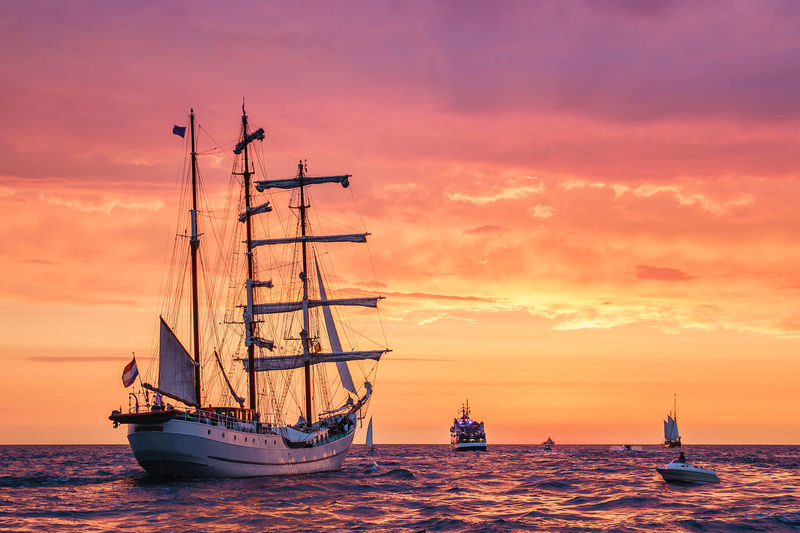 Sailing ships on the Baltic Sea in Warnemuende, Germany. Baltic Sea Hanse Sail Relaxing Rostock Sailing Ship Tall Ship Warnemünde Coast Day Evening Journey Nature No People Ocean Outdoors Shore Sky Sundown Sunset Tourism Travel Destinations Vacation Warnemuende Water Windjammer